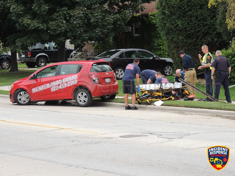One person was injured after a single vehicle accident involving a power pole and street sign in the 1200 block of Washington Avenue in Sheboygan, Wisconsin on Thursday, September 11, 2014. Photo by Asher Heimermann/Incident Response.