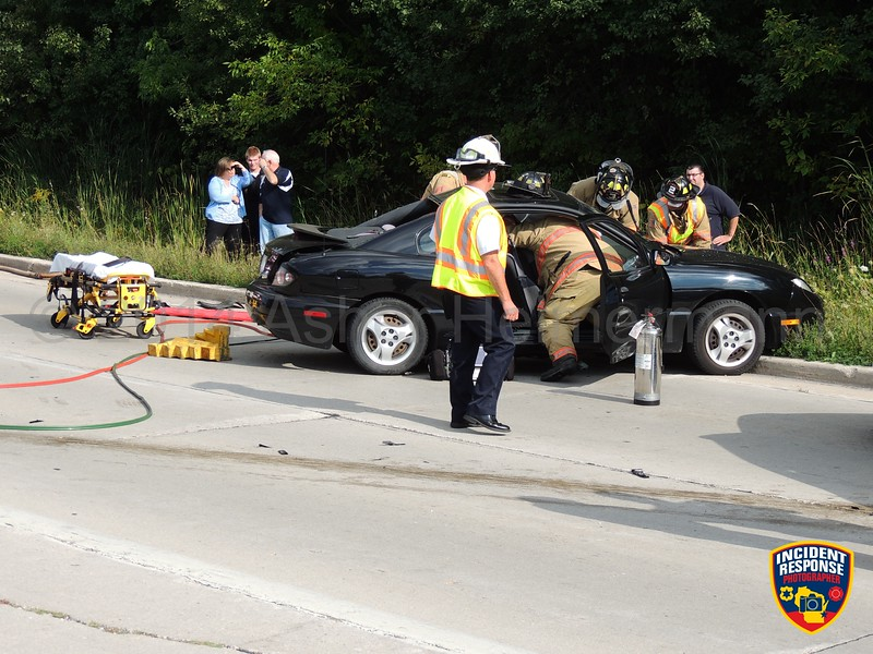 Two-vehicle crash with injuries at South Taylor Drive & University Drive in Sheboygan, Wisconsin on Wednesday, September 17, 2014. Photo by Asher Heimermann/Incident Response.