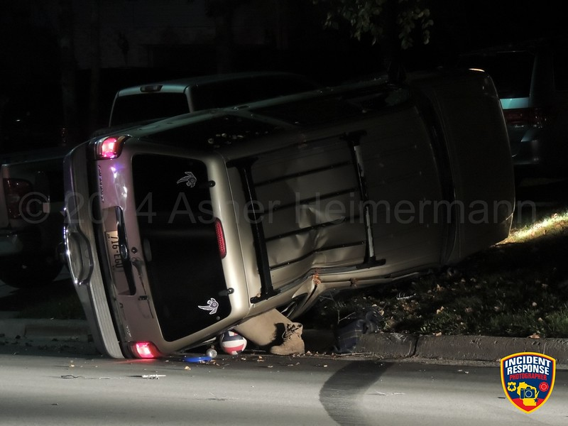 Single vehicle rollover accident in the 600 block of Dartmouth Drive in Sheboygan Falls, Wisconsin on Saturday, September 27, 2014. Photo by Asher Heimermann/Incident Response.