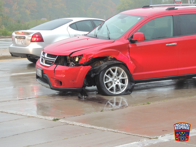 Two-vehicle accident at South Taylor Drive & Indiana Avenue in Sheboygan, Wisconsin on Thursday, October 2, 2014. Photo by Asher Heimermann/Incident Response.