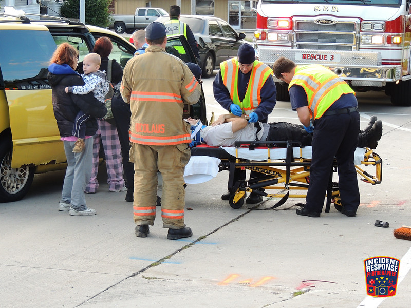 Two-vehicle crash with injuries at North 14th Street & St. Clair Avenue in Sheboygan, Wisconsin on Tuesday, October 7, 2014. Photo by Asher Heimermann/Incident Response.