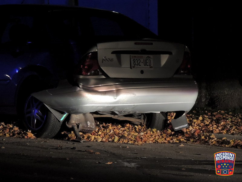 An alleged drunk driver crashed into a parked car in the 1300 block of Broadway Avenue in Sheboygan, Wisconsin on Sunday, October 26, 2014. Photo by Asher Heimermann/Incident Response.