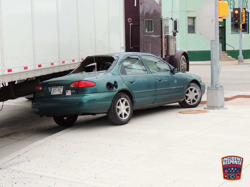 A crash involving a semi and car at North 15th Street & Calumet Drive in Sheboygan, Wisconsin on Wednesday, October 29, 2014. Photo by Asher Heimermann/Incident Response.