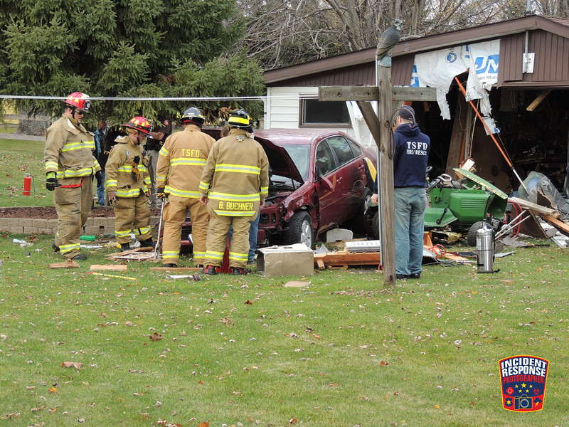 A vehicle crashed into a garage at 4009 North 45th Street in the Town of Sheboygan, Wisconsin on Friday, November 7, 2014. Photo by Asher Heimermann/Incident Response.