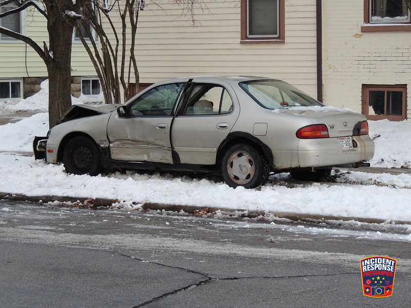 Single vehicle hit-and-run crash at North 12th Street & St. Clair Avenue in Sheboygan, Wisconsin on Wednesday, November 26, 2014. Photo by Asher Heimermann/Incident Response.