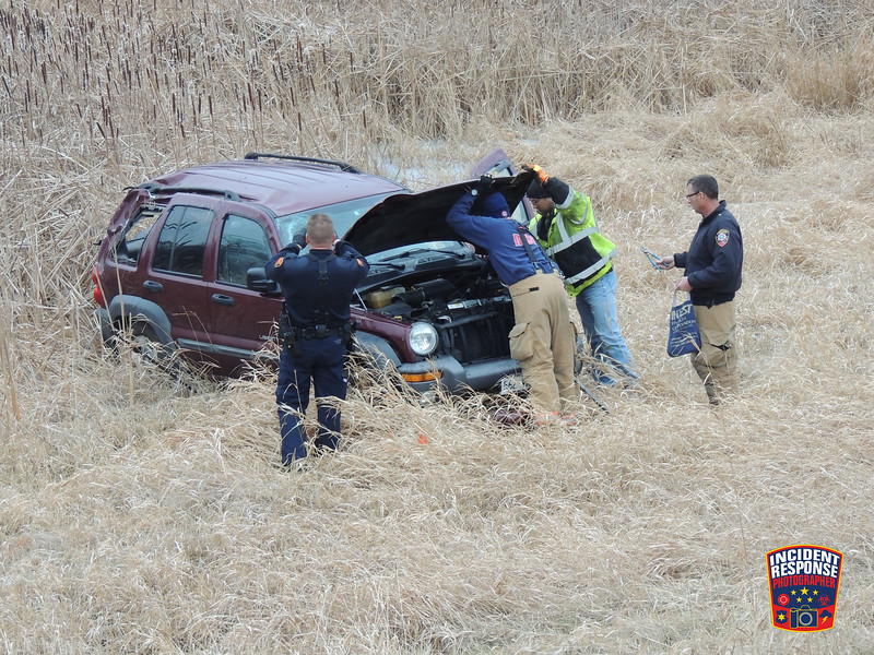 Single vehicle rollover crash at South Taylor Drive & Indiana Avenue in Sheboygan, Wisconsin on Sunday, December 21, 2014. Photo by Asher Heimermann/Incident Response.