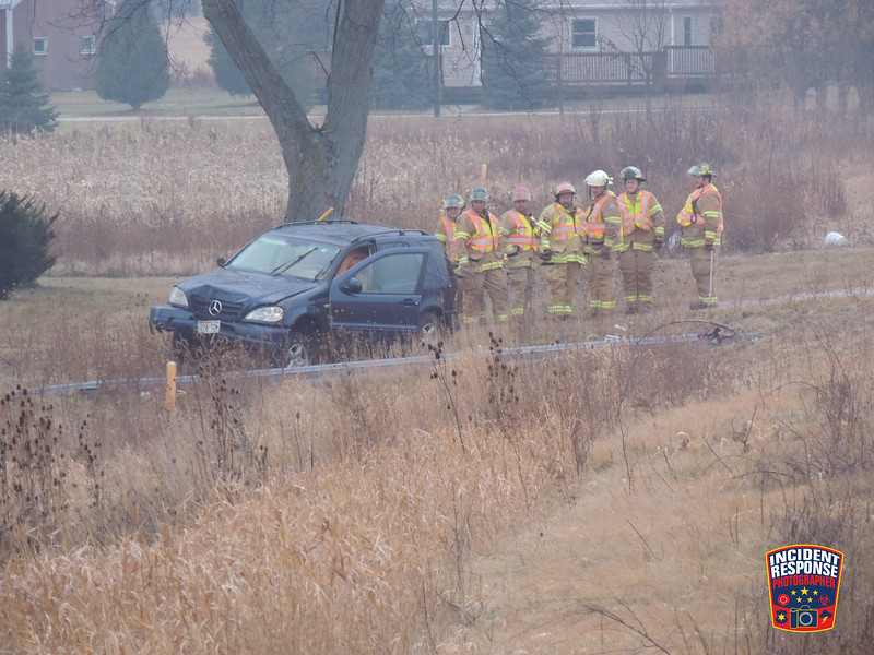 One person was injured in a single vehicle crash involving a power pole in front of W3361 Highway 28 in the Town of Lima, Wisconsin on Monday, December 22, 2014. Photo by Asher Heimermann/Incident Response.