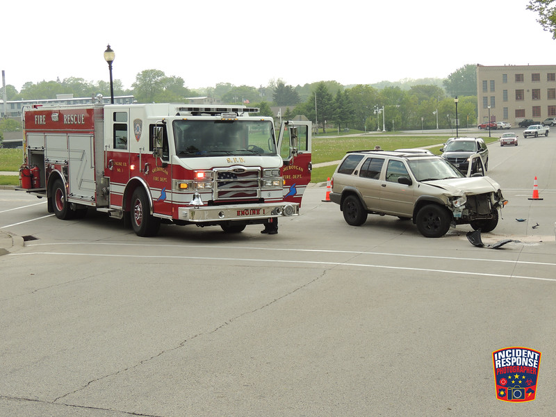 Two-vehicle crash at North 10th Street & Wisconsin Avenue in Sheboygan, Wisconsin on Thursday, June 4, 2015. Photo by Asher Heimermann/Incident Response.