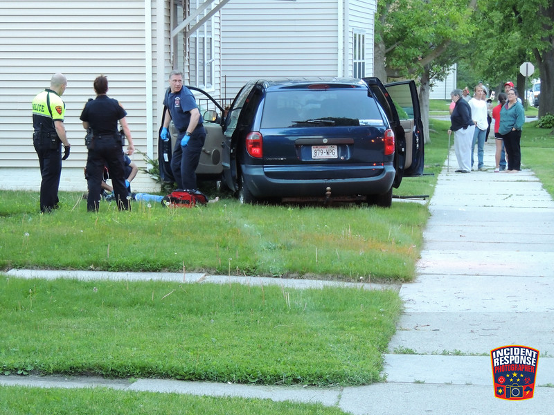 A single vehicle crash involving a stop sign and house in the 1600 block of Kentucky Avenue in Sheboygan, Wisconsin on Thursday, June 4, 2015. Photo by Asher Heimermann/Incident Response.