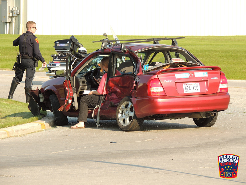 Two-vehicle crash at South Taylor Drive & Weeden Creek Road in Sheboygan, Wisconsin on Thursday, July 2, 2015. Photo by Asher Heimermann/Incident Response.