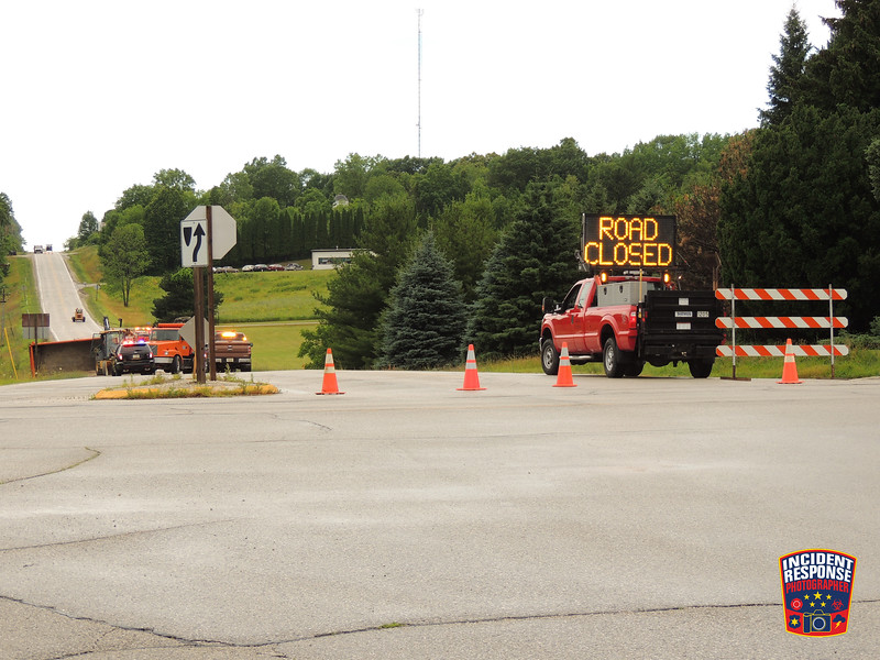 One person was injured when a Sheboygan County Highway Department dump truck overturned on County Road J west of Highway 67 in the Town of Plymouth, Wisconsin on Monday, July 13, 2015. Photo by Asher Heimermann/Incident Response.