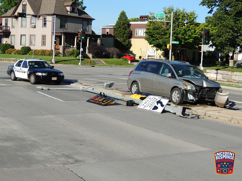 A single vehicle crash involving a traffic signal at North 14th Street & Superior Avenue in Sheboygan, Wisconsin on Sunday, July 19, 2015. Photo by Asher Heimermann/Incident Response.
