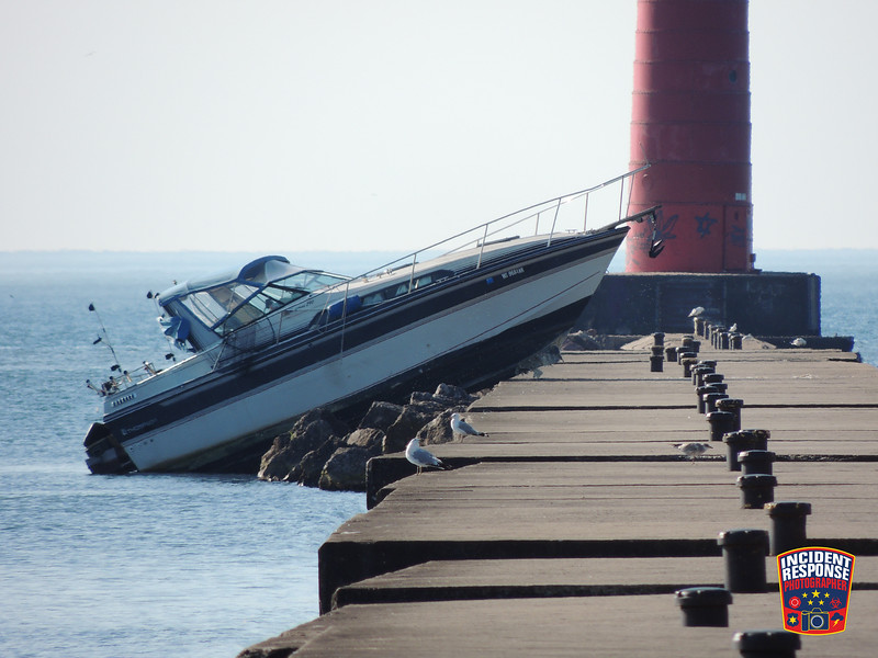 Three people were injured after their fishing boat crashed into the North Pier in Sheboygan, Wisconsin on Wednesday, July 22, 2015. Photo by Asher Heimermann/Incident Response.