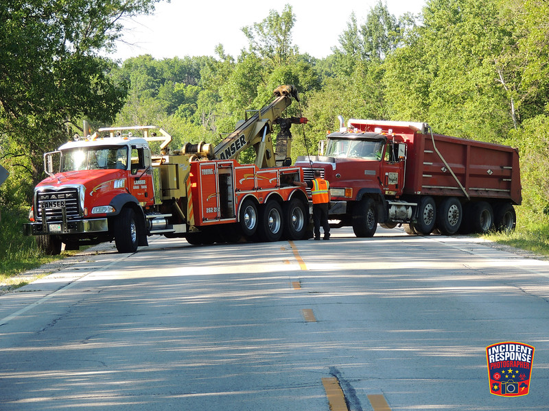 A dump truck from Baumann Excavating went off the road on Highway 67 south of Holzman Road in Town of Rhine, Wisconsin on Thursday, July 30, 2015. Photo by Asher Heimermann/Incident Response.