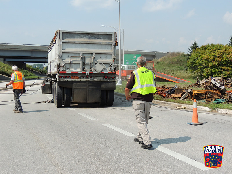 A semi driver suffered minor injuries after his semi trailer overturned on Highway 42 at Interstate 43 in the Town of Sheboygan, Wisconsin on Tuesday, September 1, 2015. Photo by Asher Heimermann/Incident Response.
