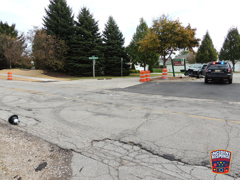 A vehicle crashed into a light and sign at Black Walnut Trail & Georgia Avenue in Sheboygan, Wisconsin on Tuesday, October 20, 2015. Photo by Asher Heimermann/Incident Response.