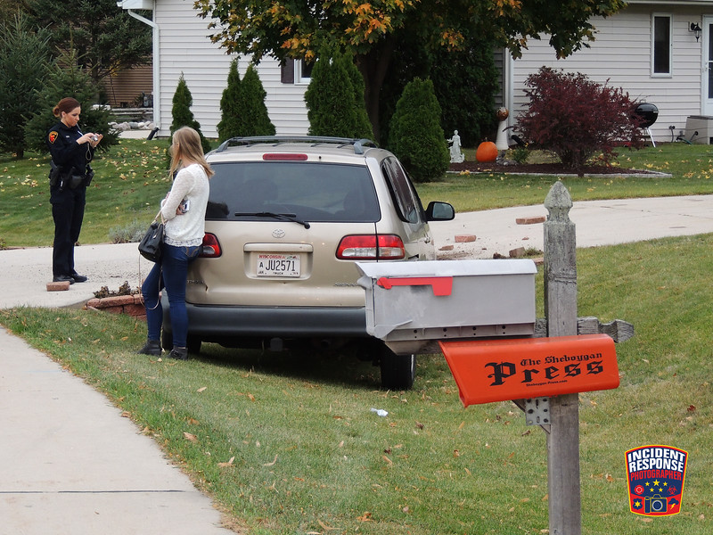 Single vehicle accident in the 1000 block of Sunnyside Avenue in Sheboygan, Wisconsin on Wednesday, October 21, 2015. Photo by Asher Heimermann/Incident Response.