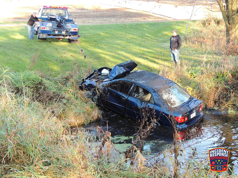 A vehicle rolled over into the Stony Creek on County Road D in the Town of Scott, Wisconsin on Sunday October 25, 2015. Photo by Asher Heimermann/Incident Response.