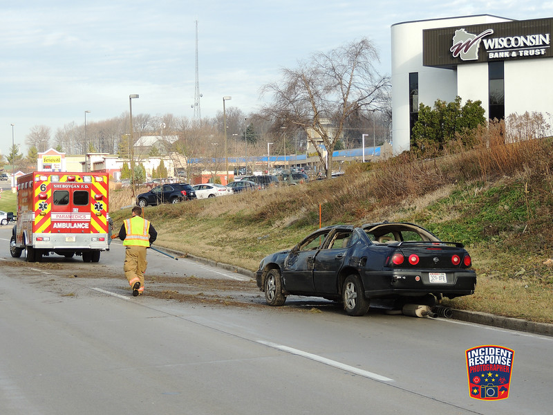 A driver and baby survived a rollover crash in the 600 block of South Taylor Drive in Sheboygan, Wisconsin on Wednesday, November 25, 2015. Photo by Asher Heimermann/Incident Response.