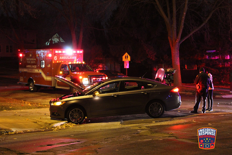 Two-vehicle crash at South 10th Street & Georgia Avenue in Sheboygan, Wisconsin on Wednesday, November 25, 2015. Photo by Asher Heimermann/Incident Response.