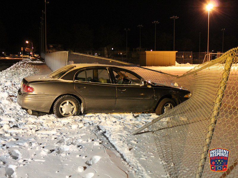 Single vehicle crash involving a fence at North 11th Street & Grand Avenue in Sheboygan, Wisconsin on Saturday, January 2, 2016. Photo by Asher Heimermann/Incident Response.