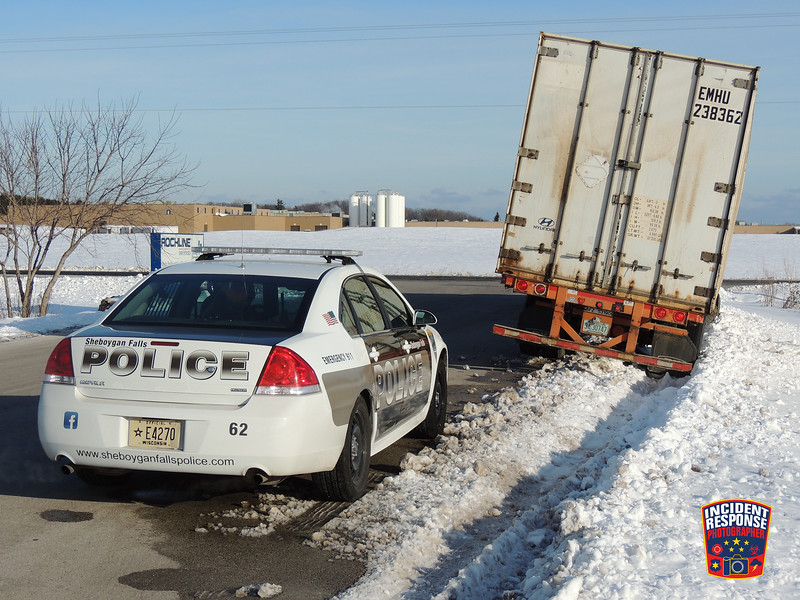 A semi became stuck in the snow at N5252 County Road TT in Sheboygan Falls, Wisconsin on Tuesday, January 5, 2016. Photo by Asher Heimermann/Incident Response.