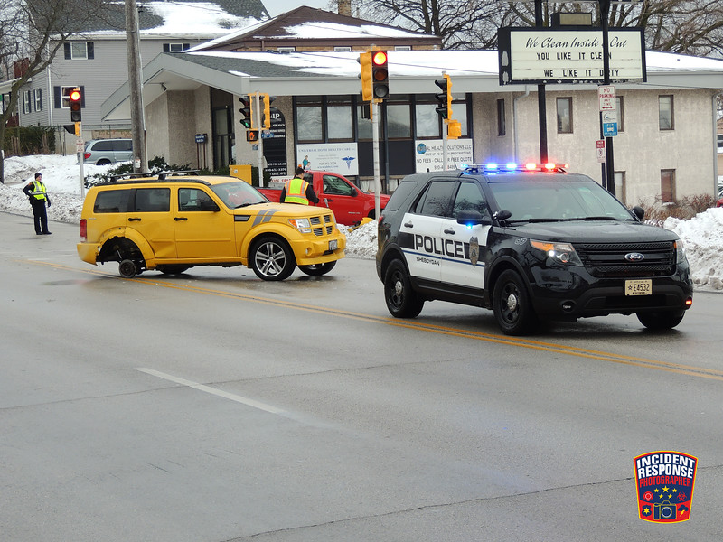Two-vehicle crash with injuries at North 10th Street & Erie Avenue in Sheboygan, Wisconsin on Thursday, January 7, 2016. Photo by Asher Heimermann/Incident Response.