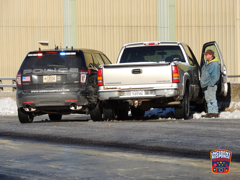 A Sheboygan Police squad was rear-ended by a pick-up truck on the South Business Drive viaduct on Sunday, January 10, 2016. Photo by Asher Heimermann/Incident Response.