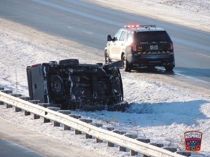 A pick-up truck flipped over on southbound Interstate 43 south of County Road PP in Kohler, Wisconsin on Tuesday, January 12, 2016. Photo by Asher Heimermann/Incident Response.