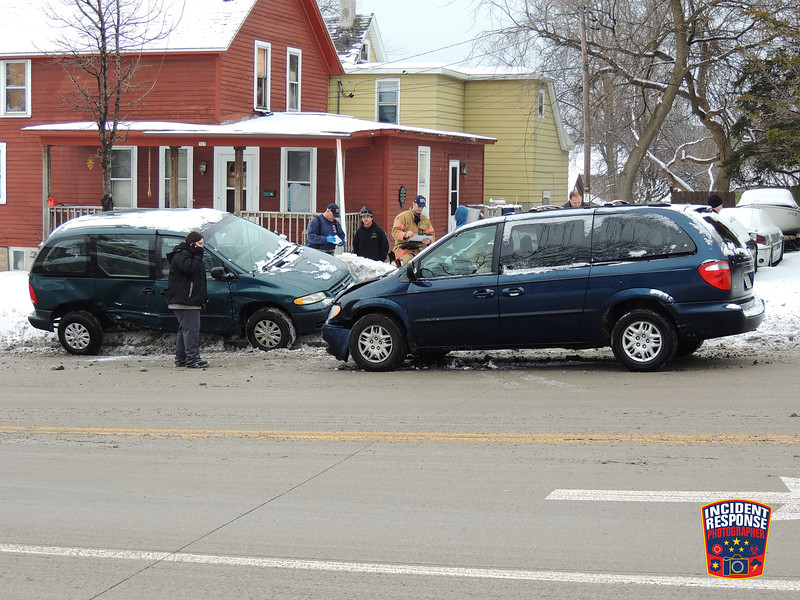Two-vehicle crash involving a Sheboygan Area School District special-needs student transport van in the 500 block of North 14th Street in Sheboygan, Wisconsin on Thursday, January 14, 2016. Photo by Asher Heimermann/Incident Response.