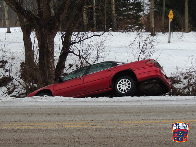 A car slid into a ravine at Mill Road & River Ridge Drive in the Town of Sheboygan, Wisconsin on Tuesday, February 2, 2016. Photo by Asher Heimermann/Incident Response.