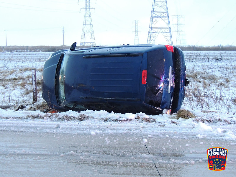 Single vehicle rollover crash on Interstate 43 south of Highway 28 in Sheboygan, Wisconsin on Tuesday, February 2, 2016. Photo by Asher Heimermann/Incident Response.