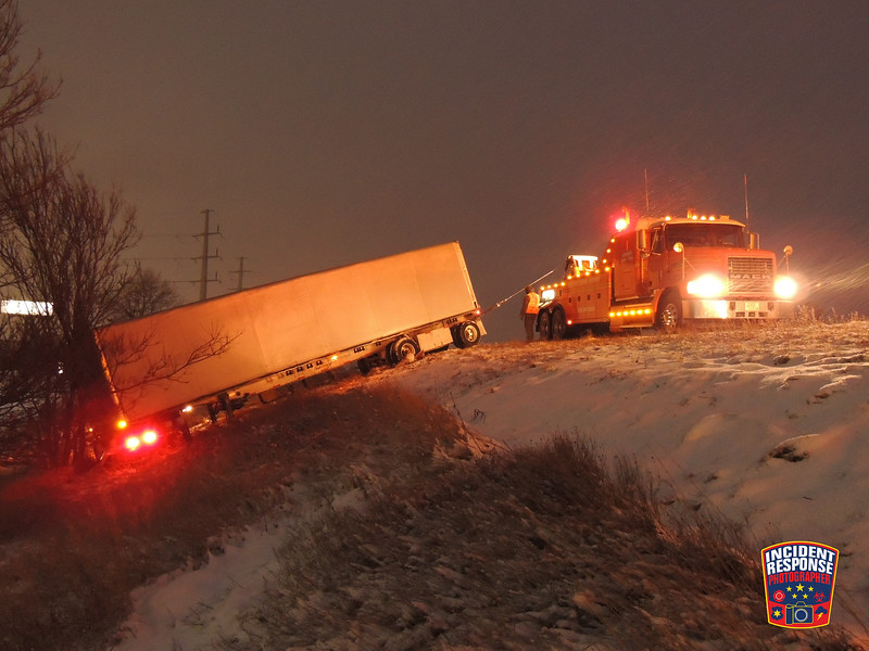 A semi tractor-trailer jackknifed on northbound Interstate 43 at Highway 42 in the Town of Sheboygan, Wisconsin on Monday, February 8, 2016. Photo by Asher Heimermann/Incident Response.