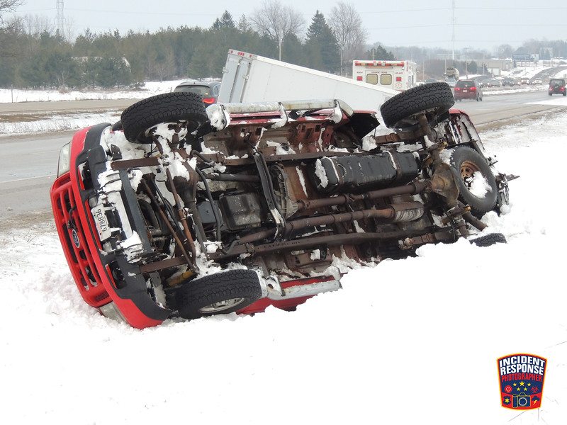 A pick-up truck pulling a trailer rolled over on State Highway 23 east of Hillside Road in the Town of Sheboygan Falls, Wisconsin on Thursday, February 18, 2016. Photo by Asher Heimermann/Incident Response.