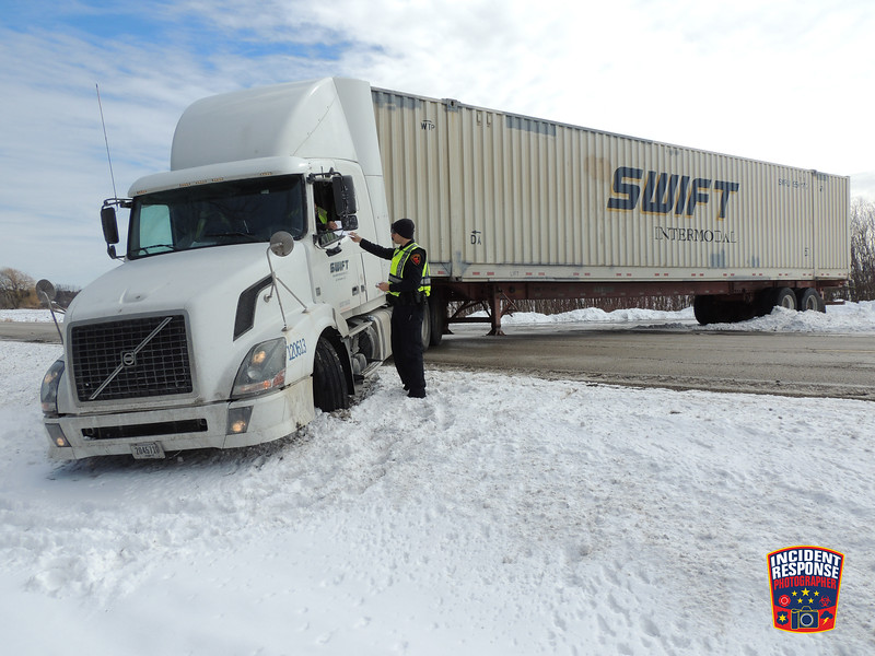 A semi from Swift Intermodal became stuck in a ditch in the 2400 block of Weeden Creek Road in Sheboygan, Wisconsin on Wednesday, March 2, 2016. Photo by Asher Heimermann/Incident Response.
