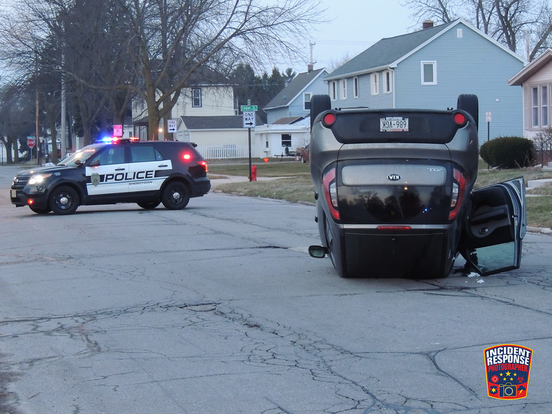 A driver fled from the scene of a rollover crash in the 2300 block of North 13th Street in Sheboygan, Wisconsin on Tuesday, March 22, 2016. Photo by Asher Heimermann/Incident Response.