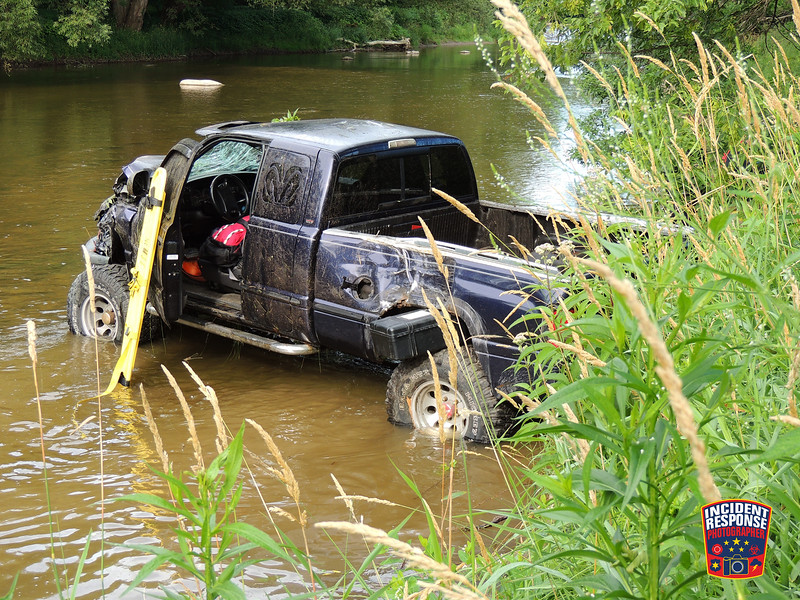 A driver was injured after the pick-up truck he was operating crashed into a power pole and into the Sheboygan River on Indiana Avenue in Sheboygan, Wisconsin on Monday, July 18, 2016. Photo by Asher Heimermann/Incident Response.