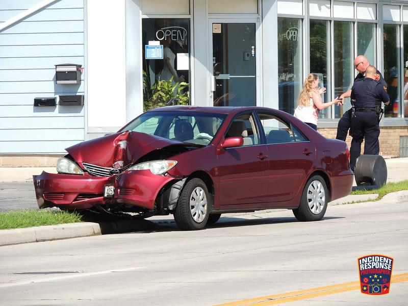 Single vehicle crash involving a light pole on Calumet Drive near Cooper Avenue in Sheboygan, Wisconsin on Monday, July 18, 2016. Photo by Asher Heimermann/Incident Response.