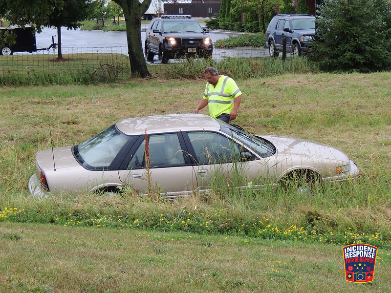 A driver reportedly lost control while driving through a slick roundabout on Highway 42 at Interstate 43 in the Town of Sheboygan, Wisconsin on Thursday, July 21, 2016. Photo by Asher Heimermann/Incident Response.