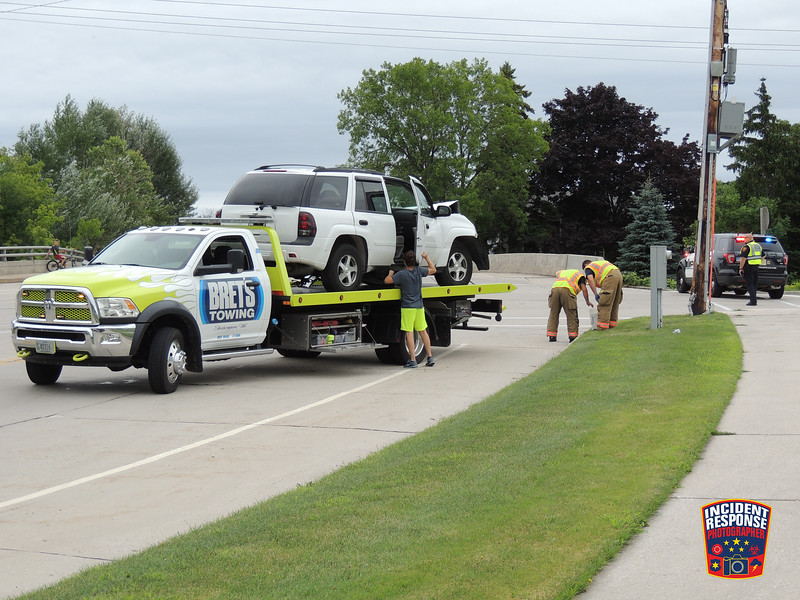 Single vehicle crash with injuries involving a power pole at Superior Avenue & North 18th Street in Sheboygan, Wisconsin on Thursday, July 28, 2016. Photo by Asher Heimermann/Incident Response.