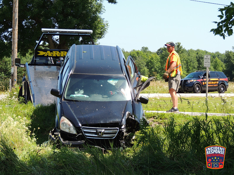 Two-vehicle crash with injuries on County Road LS at Playbird Road in the Town of Mosel, Wisconsin on Sunday, July 31, 2016. Photo by Asher Heimermann/Incident Response.