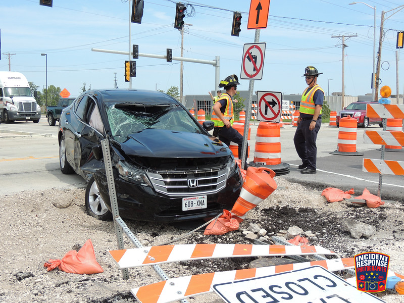 Two-vehicle crash involving a dump truck at South Taylor Drive & Washington Avenue in Sheboygan, Wisconsin on Tuesday, August 23, 2016. Photo by Asher Heimermann/Incident Response.