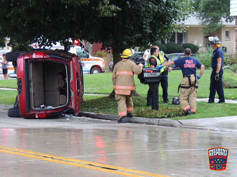 Several children were taken to Aurora Sheboygan Memorial Medical Center after sustaining non-life threatening injuries in a rollover crash at North 8th Street & Pershing Avenue in Sheboygan, Wisconsin on Monday, September 19, 2016. Photo by Asher Heimermann/Incident Response.