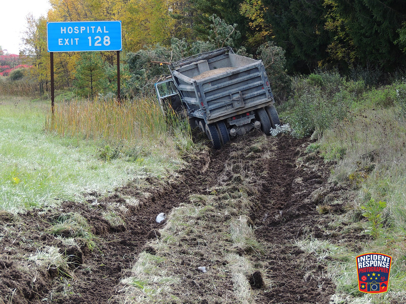 A dump truck went off road and crashed into a tree on southbound Interstate 43 near Playbird Road in Sheboygan, Wisconsin on Thursday, October 14, 2016. Photo by Asher Heimermann/Incident Response.