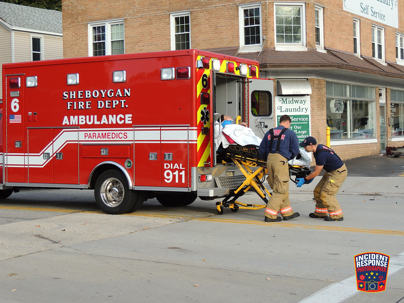 Two-vehicle crash involving a building at North 14th Street & Michigan Avenue in Sheboygan, Wisconsin on Friday, October 21, 2016. Photo by Asher Heimermann/Incident Response.