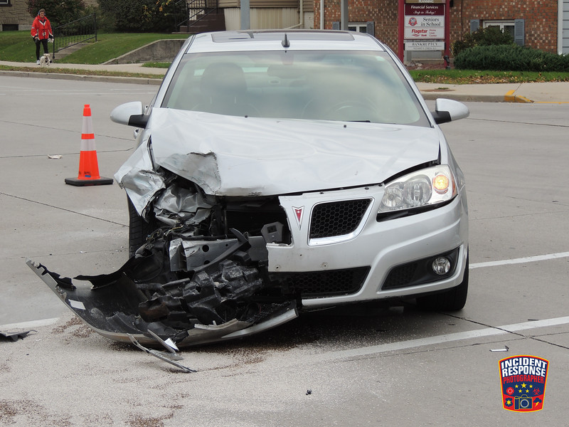Two-vehicle crash with injuries at North 14th Street & Pennsylvania Avenue in Sheboygan, Wisconsin on Friday, October 21, 2016. Photo by Asher Heimermann/Incident Response.
