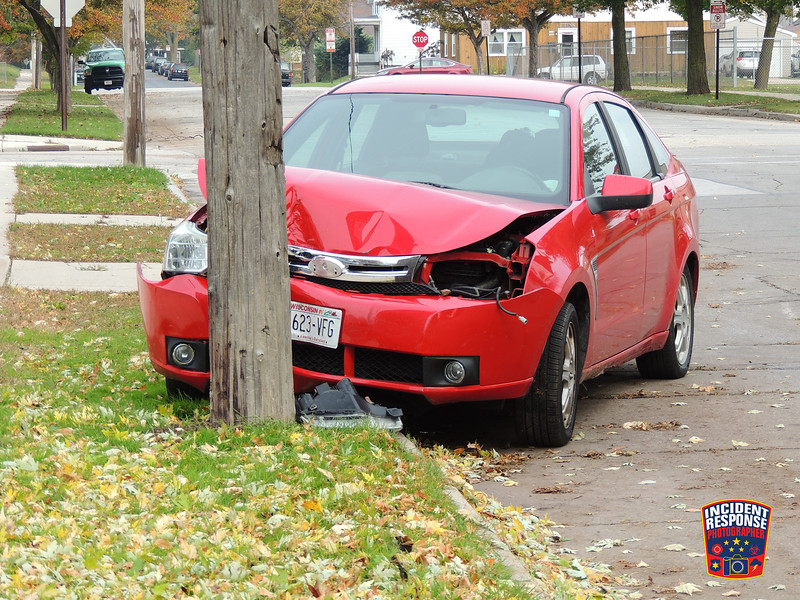 Single vehicle crash involving a power pole in the 900 block of South 15th Street in Sheboygan, Wisconsin on Friday, October 28, 2016. Photo by Asher Heimermann/Incident Response.