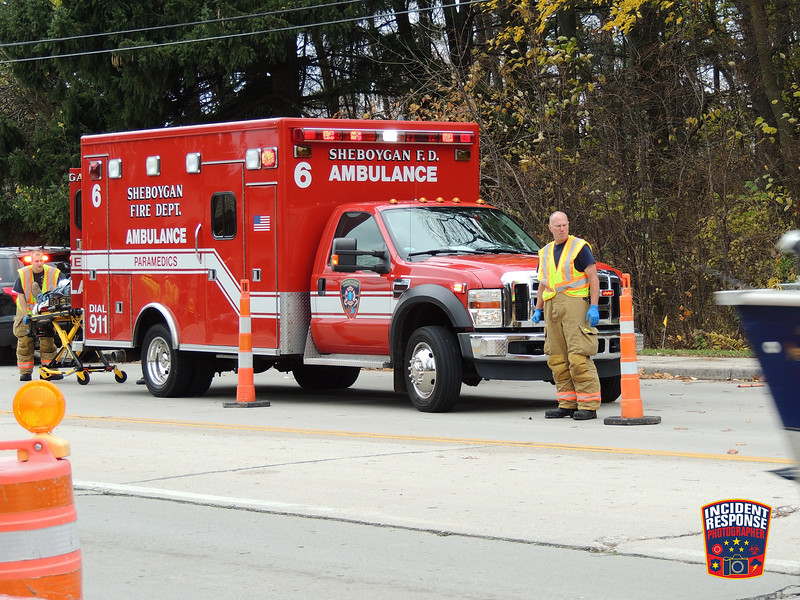 A construction worker was struck and injured by an SUV near North 27th Street & Calumet Drive in Sheboygan, Wisconsin on Tuesday, November 8, 2016. Photo by Asher Heimermann/Incident Response.