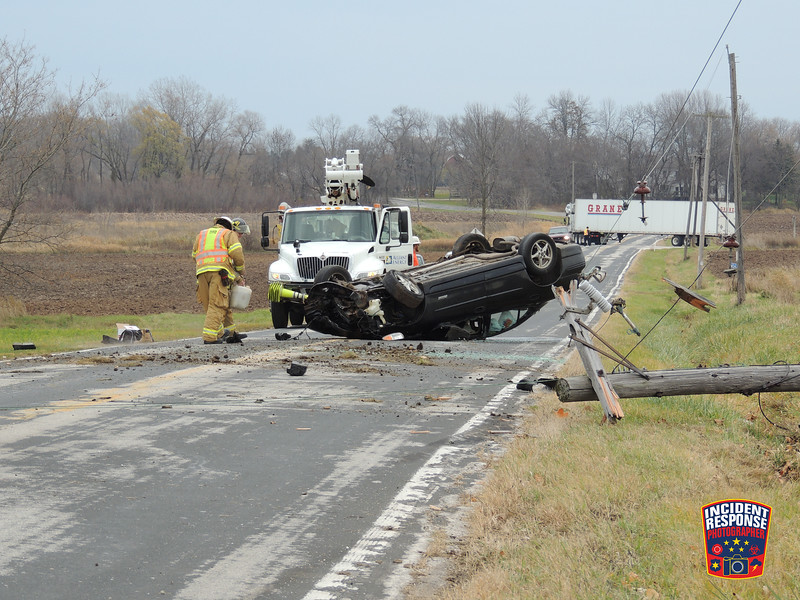 Single vehicle rollover crash involving a power pole in front of 3472 County Road PP in the Town of Sheboygan Falls, Wisconsin on Friday, November 18, 2016. Photo by Asher Heimermann/Incident Response.
