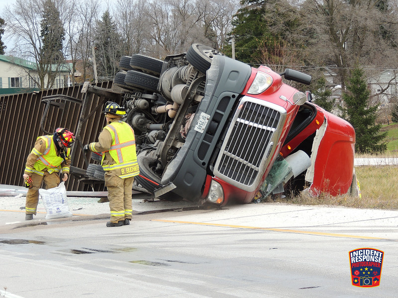 A semi tractor trailer carrying rolls of paper weighting about 44,000 pounds tipped over on the Interstate 43 northbound on-ramp from eastbound Highway 23 in Sheboygan, Wisconsin on Friday, December 2, 2016. Photo by Asher Heimermann/Incident Response.